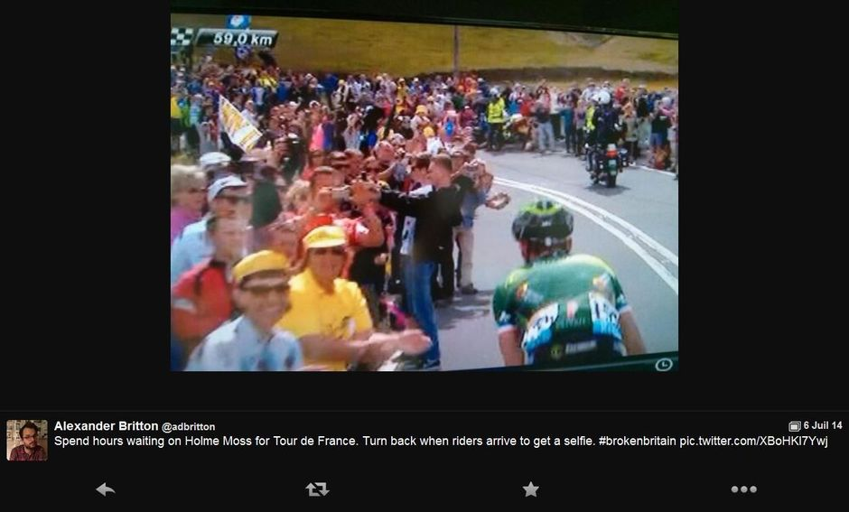 Spend hours waiting on Holme Moss for Tour de France. Turn back when riders arrive to get a selfie. #brokenbritain pic.twitter.com/XBoHKI7Ywj -- Alexander Britton (@adbritton) July 6, 2014